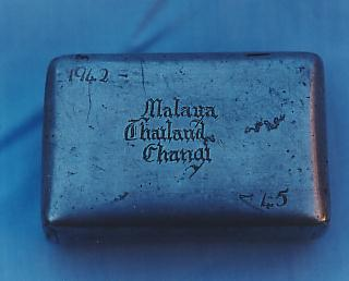 Tobacco tin  made from the baffle of a zero fighter bomber in 1945
